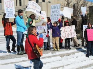 In this March 25, 2013, photo, abortion-rights supporters rally at the state Capitol in Bismarck, N.D.