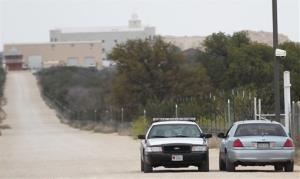Texas Department of Public Safety cars idle along a road on the Yearning for Zion Ranch, Thursday, April 17, 2014, near Eldorado, Texas. State agents have seized the property, which belonged to the Fundamentalist Church of Jesus Christ of Latter Day Saints, and was where hundreds of children were removed...
