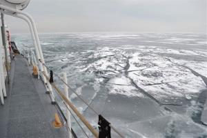 In this Feb. 12, 2014 file photo the Coast Guard Cutter Biscayne Bay, a 140-foot ice-breaking tug, sails through ice covered waters toward the shores off Indiana.