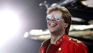 FILE - In this  Sunday, June 12, 2011, file photo, US musician Jon Bon Jovi performs at the Olympic Stadium in Munich, southern Germany, during his European Open Air Tour'. Bon Jovi won top honors at the Billboard Touring Awards and Georgie Strait has been named the 2013 Legend of...