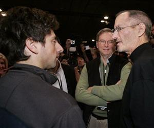 Apple CEO Steve Jobs, right, talks with Google founder Sergey Brin, left, as Google CEO Eric Schmidt, center, looks on during a MacWorld Conference in this Jan. 15, 2008 file photo.