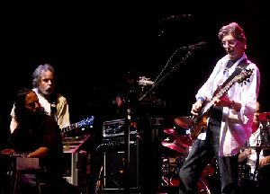 In this Feb. 4, 2008 file photo, Phil Lesh, right, performs during a fundraising concert  in San Francisco while Grateful Dead band mate Bob Weir, standing at left, looks on.