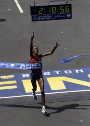 Rita Jeptoo of Kenya breaks the tape to win the women's division of the 118th Boston Marathon Monday, April 21, 2014.