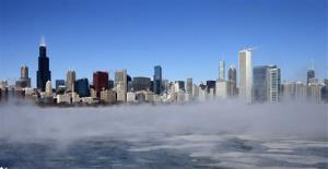 The Chicago Skyline sits as a backdrop as fog drifts across Monroe Harbor with temperatures well below zero and wind chills expected to reach 40 to 50 below, Monday, Jan. 6, 2014, in Chicago.