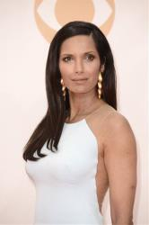 Padma Lakshmi, wearing KaufmanFranco, arrives at the 65th Primetime Emmy Awards at Nokia Theatre on Sunday Sept. 22, 2013, in Los Angeles.