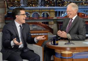 "Comedy Central's Stephen Colbert, left, joins host David Letterman on the set of the ""Late Show with David Letterman."