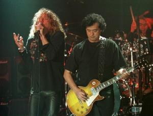 In this in this March 5, 1998, file photo, Led Zeppelin's Robert Plant  performs with guitarist Jimmy Page during a concert in Istanbul.