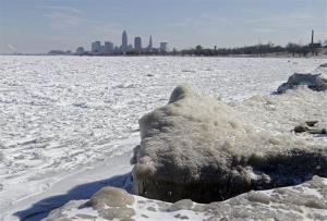 Ice covers Lake Erie west of downtown Cleveland Friday, Feb. 28, 2014.