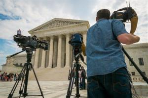 Videojournalists set up outside of the Supreme Court in Washington Tuesday.
