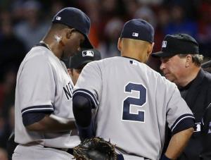Home plate umpire Gerry Davis, right, confers on the mound with New York Yankees starting pitcher Michael Pineda, left.