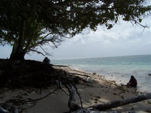 In this April 25, 2007 file photo, a woman gathers shellfish on an eroded beach on Majuro Atoll in the Marshall Islands.