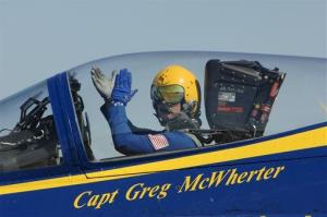 In this 2011 photo provided by the U.S. Navy, Capt. Greg McWherter responds to the crowd during a show.
