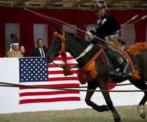 President Barack Obama watches a Yabusame or horseback archery demonstration as he tours Meiji Shrine in Tokyo, April 24, 2014.