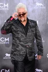 Guy Fieri arrives at the 49th annual Academy of Country Music Awards at the MGM Grand Garden Arena on Sunday, April 6, 2014, in Las Vegas.