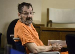 Frazier Glenn Cross, who is also known as Frazier Glenn Miller, looks around after being wheeled into a Johnson County courtroom for a scheduling session on Thursday, April 24, 2014, in Olathe, Kan.