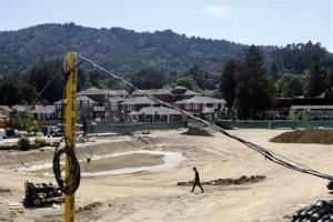 In this April 16, 2014 photo, workers continue with the construction of Rose Lane Development in Larkspur, Calif.