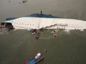 In this April 16, 2014 file photo, South Korean rescue team boats and fishing boats try to rescue passengers of the sinking ferry Sewol in the water off South Korea's southern coast, near Jindo.