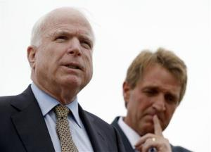 Sen. John McCain, left, R-AZ, and Sen. Jeff Flake, R-AZ, hold a news conference to discuss recent reports that dozens of VA hospital patients in Arizona may have died while awaiting medical care in the Phoenix VA Health Care System, adjacent to the VA Hospital on Friday, April 18, 2014,...