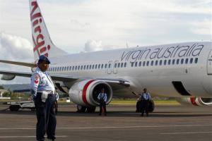 Indonesian Air Force personnel stand guard by a Virgin Australia airplane in Bali today.