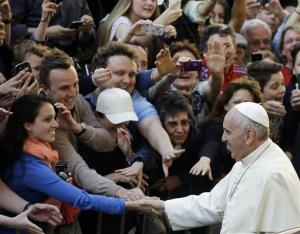 Pope Francis arrives outisde at St. ' Ignazio church in Rome Thursday.