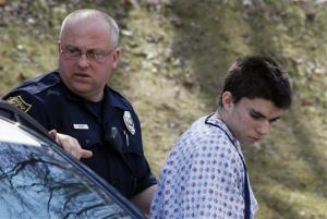 Alex Hribal is escorted by police to a district magistrate to be arraigned on Wednesday, April 9, 2014, in Export, Pa.