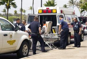 The 15-year-old stowaway, seen sitting on a stretcher center, is loaded into an ambulance at Kahului Airport in Kahului, Maui, Hawaii Sunday afternoon, April 20, 2014.