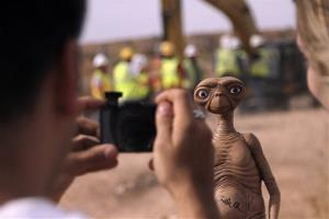 A man takes a photo of an ET doll in Alamogordo, N.M, Saturday, April 26, 2014.