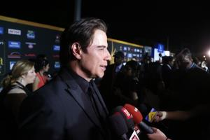 Actor John Travolta walks the green carpet as he arrives for the 15th annual International Indian Film Awards on Saturday, April 26, 2014, in Tampa, Fla.