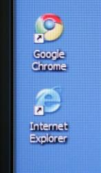 Google's Chrome browser shortcut is shown next to Microsoft's Internet Explorer browser shortcut during a news conference at Google Inc. headquarters.