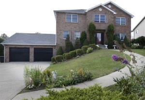 The home of Eileen Battisti is seen in her neighborhood in Aliquippa, Pa.