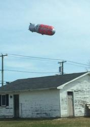 The Red Zeppelin blimp floats over New Brunswick.
