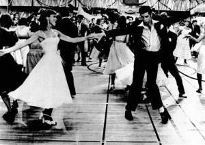 John Travolta, right, and Olivia Newton-John in a scene from the film Grease.