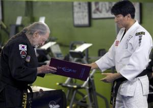 Willie Nelson, the country music icon who turns 81 this week, bows as he receives his fifth-degree black belt in the martial art of Gong Kwon Yu Sul on Monday, April 28, 2014, in Austin, Texas.