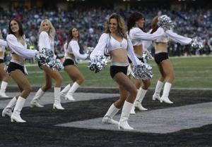 Oakland Raiders cheerleaders perform during the second half of an NFL football game against the Denver Broncos in Oakland, Calif., Sunday, Dec. 29, 2013.