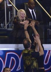 Shelly Sterling, estranged wife of Donald Sterling, high-fives fans in the final seconds of the game.