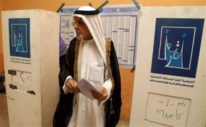 An Iraqi man prepares to casts his vote at a polling station in Basra, Iraq's second-largest city.