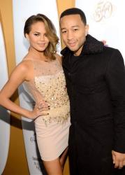 Model Chrissy Teigen and husband singer John Legend attend the 2014 Sports Illustrated Swimsuit 50th Anniversary Issue kickoff event at Swimsuit Beach House, Tuesday, Feb. 18, 2014, in New York.