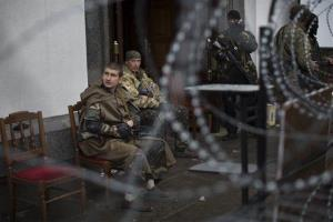 Pro-Russian gunmen in camouflage uniforms guard an entrance of an administration building they seized in Luhansk earlier this week.