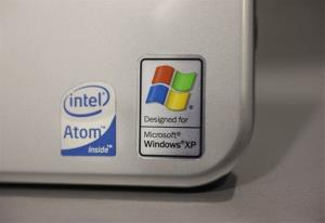 This file photo shows a Windows XP logo on a Hewlett Packard laptop.