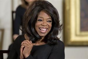 Oprah Winfrey smiles before being awarded the Presidential Medal of Freedom.