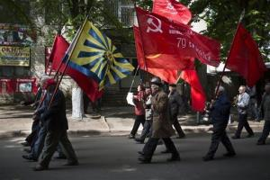 Local citizens marched Soviet flags as they marked May Day in Slovyansk, eastern Ukraine yesterday.