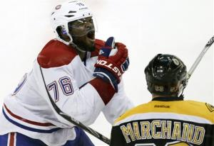 Montreal Canadiens defenseman P.K. Subban (76) reacts after getting hit in the face by Boston Bruins left wing Brad Marchand's stick during the second period.