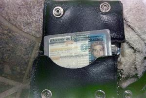 This April 1994 photo from the Seattle Police Department shows a wallet containing Kurt Cobain's Washington state driver's license, found at the scene of his suicide.