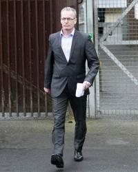 Sinn Fein's Gerry Kelly leaves Antrim Police station in Antrim, Northern Ireland, Sunday, May 4, 2014.