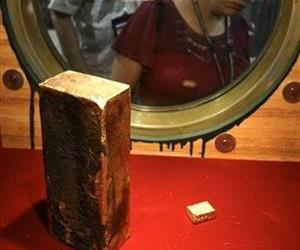 This Aug. 10, 2010 photo shows a gold ingot weighing more than 662 ounces recovered from the shipwreck of the SS Central America which sank in 1857.