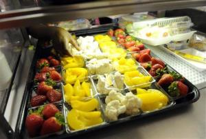 In this Tuesday, April 29, 2014 photo, fruit and vegetables are served during lunch at the Patrick Henry Elementary School in Alexandria, Va.