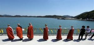 Monks march during a Buddhist ceremony for  the deceased and the missing passengers of the sunken ferry Sewol.
