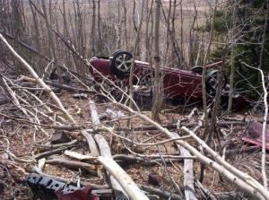 In this May 2014, photo provided by the Park County Sheriff's Office, Kristin Hopkins' car is seen after she drove off the roadway near the old mining town of Fairplay, Colo.