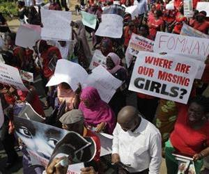Women attend a mass-demonstration calling on the government to rescue the hundreds of missing kidnapped school girls of a government secondary school Chibok, in Lagos, Nigeria, Monday.