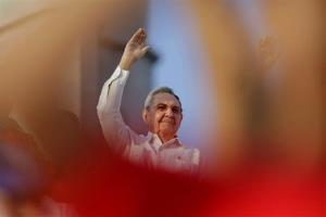 Cuba's President Raul Castro waves to workers as he watches the May Day march in Havana, Cuba, Thursday, May 1, 2014.